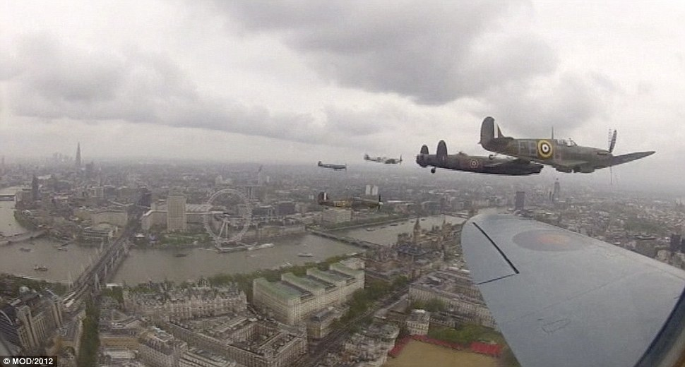 In formation: Incredible footage has been released showing the view enjoyed by crew aboard a Lancaster bomber flying over London for the Queen's Diamond Jubilee celebrations